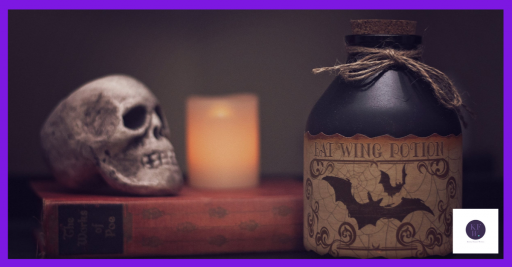 Hallowe'en skull, book and bottle.