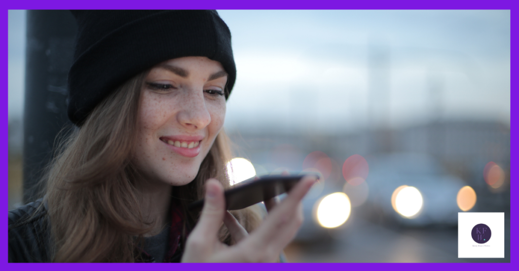 Woman smiling at phone. Sharing values in marketing.