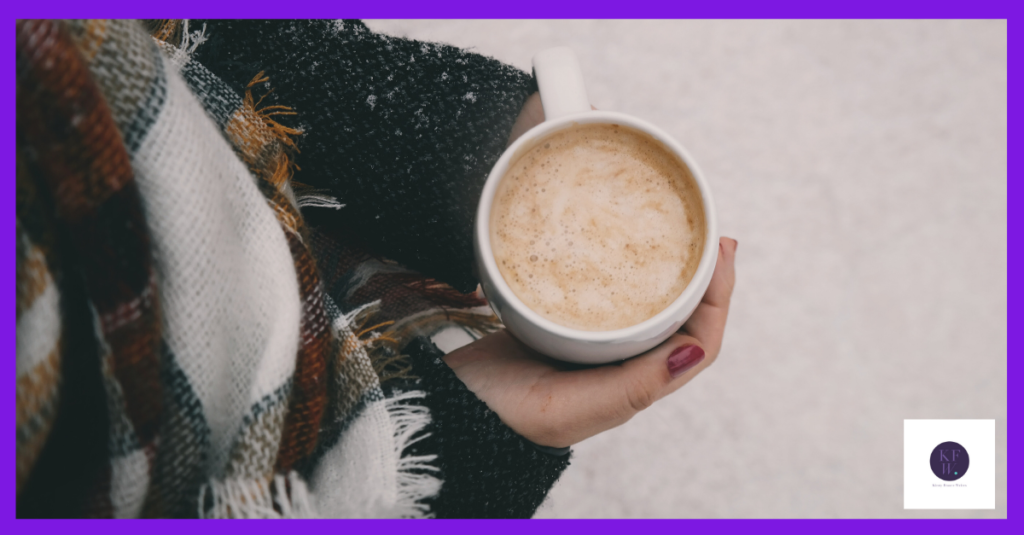 A woman with hot chocolate getting ready to plan her Christmas marketing