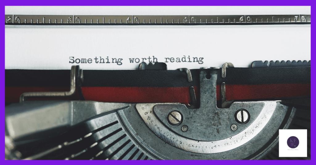 Typewriter with writing saying 'something worth reading'
